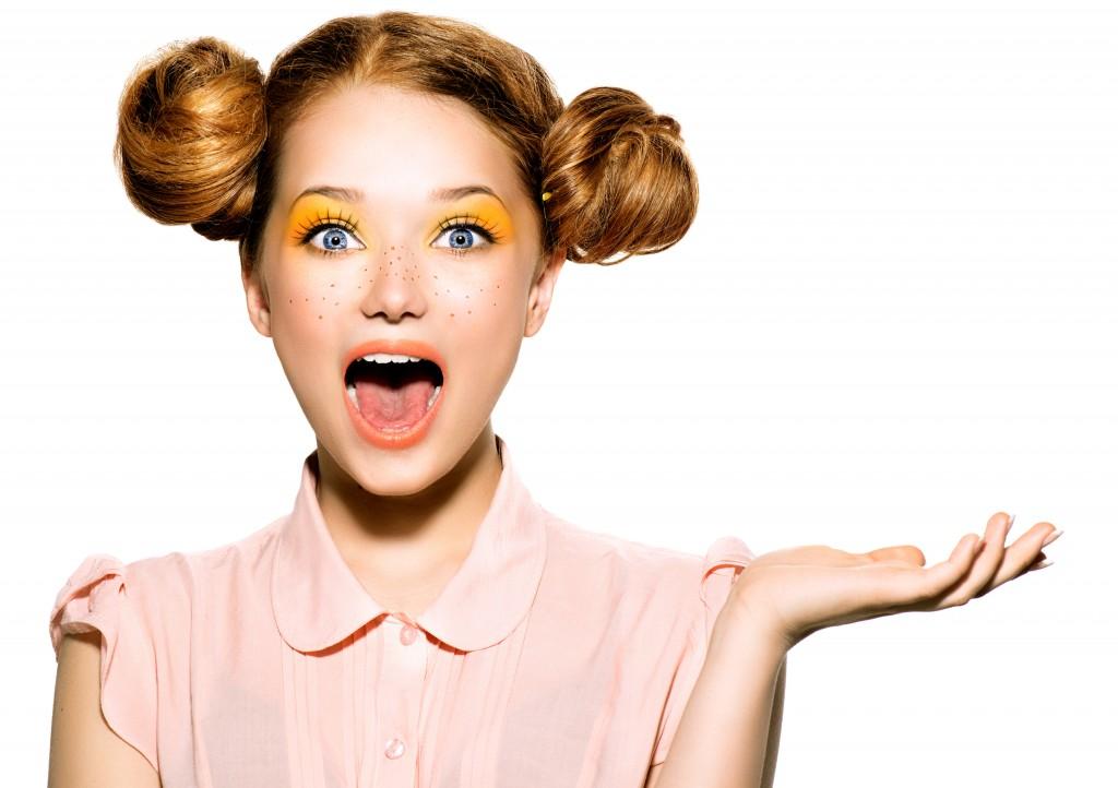 Beautiful joyful teen girl with freckles and yellow makeup